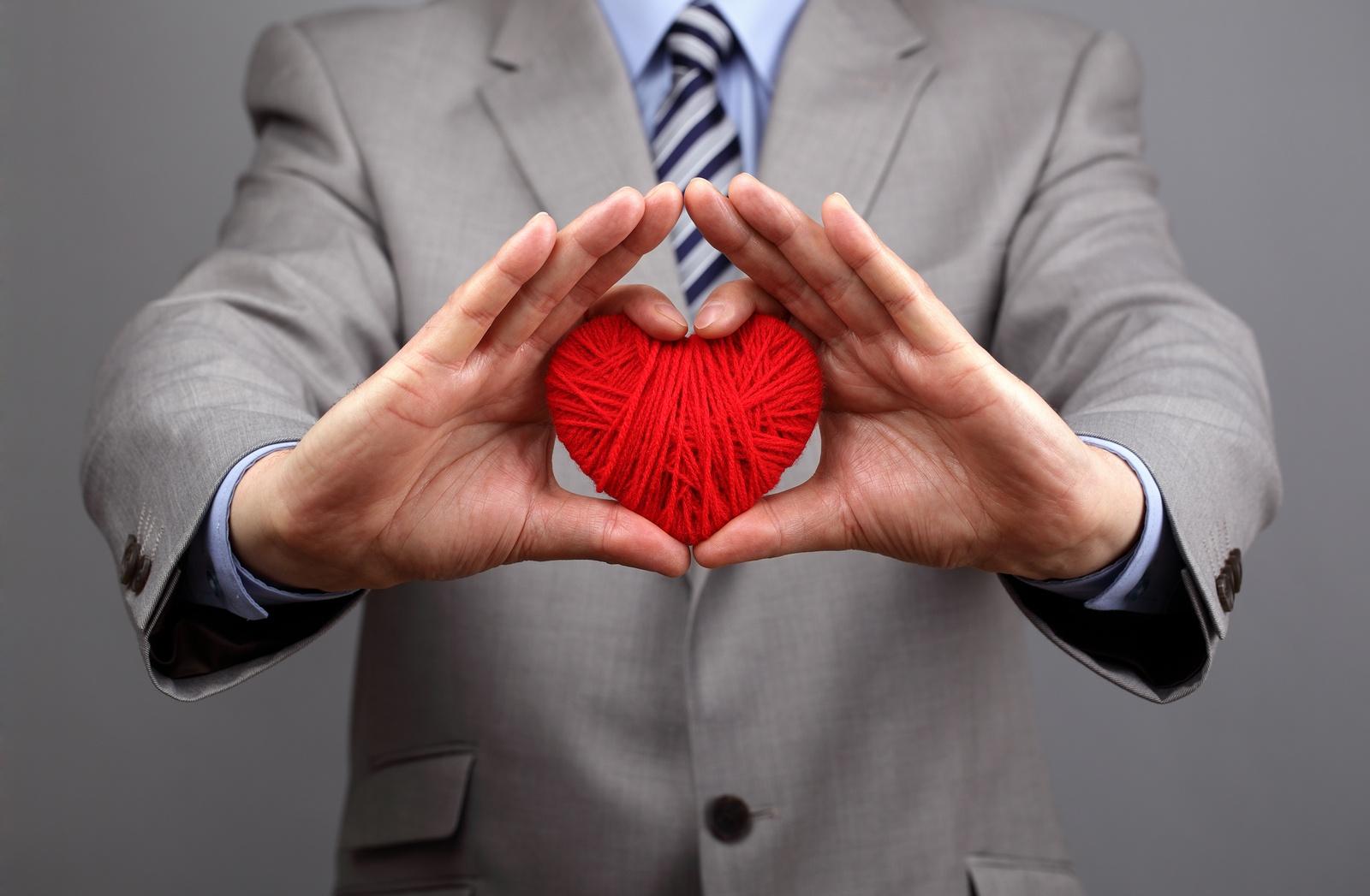 bigstock-Man-holding-a-red-woolen-heart-56186573